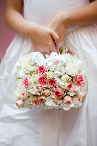 flower-girl-basket-covered-in-pink-and-white-roses