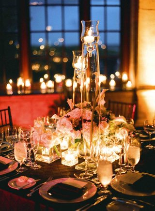 tall-floating-candles-and-short-floral-arrangement
