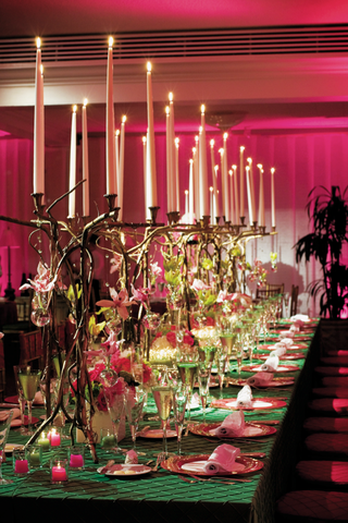 table-covered-with-green-tablecloth-and-candelabras-of-twisted-branches