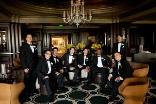 groom-with-friends-in-tuxedos-in-swanky-hotel