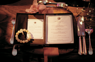 brown-and-white-menu-with-prayer-bead-bracelet