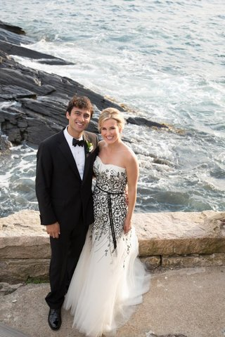 bride-and-groom-on-stone-cliff-above-ocean