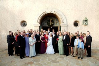 bride-and-groom-with-guests-in-front-of-church