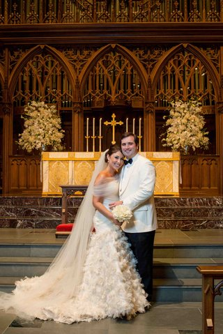 bride-and-groom-at-church-ceremony-altar