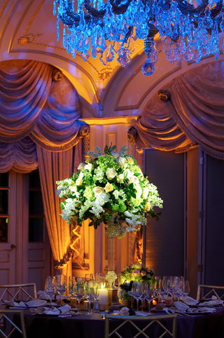 blue-chandelier-over-formal-ballroom-wedding-table
