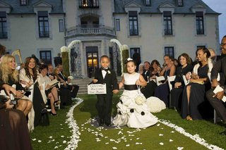 flower-girl-and-ring-bearer-holding-sign-at-oheka-castle