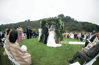 outdoor-ceremony-on-grass-with-guests-surrounding-the-chuppah