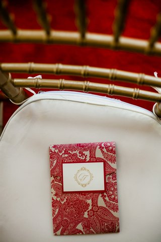 gold-chair-topped-with-paisley-ceremony-booklet