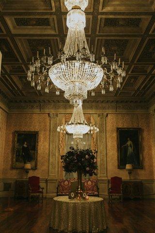 rosecliff-mansion-newport-rhode-island-wedding-reception-chandelier-flower-arrangement-silhouettes