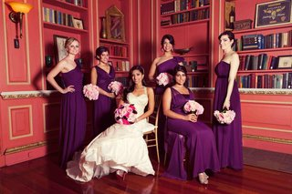 bride-sitting-down-with-bridesmaids-in-library-room