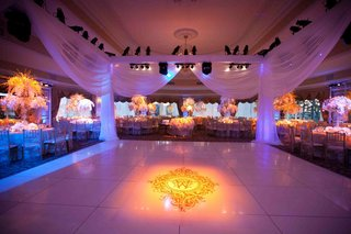 wedding-reception-dance-flower-with-draped-edging-and-projected-monogram