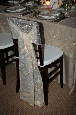 sheer-linen-with-with-gold-embroidery-on-tables-and-chairs