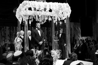 black-and-white-photo-of-groom-waiting-at-altar