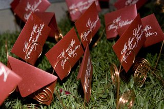 red-seating-cards-with-white-ink-calligraphy-names