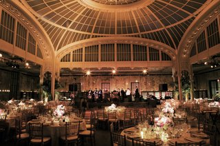 domed-ceiling-with-round-tables-and-stage