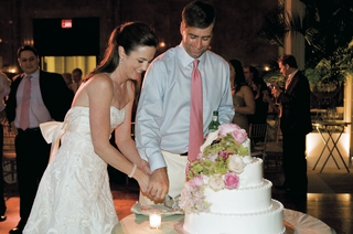 couple-cuts-four-layer-cake-at-reception