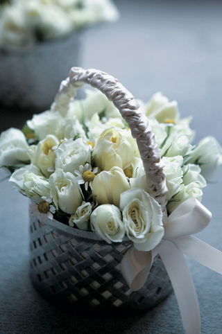 taupe-purple-basket-filled-with-cream-flowers
