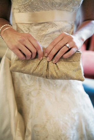 bride-holding-clutch-with-sparkling-sequins