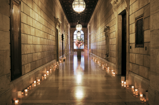 stone-hall-illuminated-by-candles-and-lanterns
