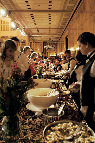 guests-and-caterers-at-buffet-style-station