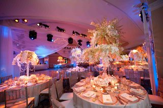 wedding-reception-centerpiece-with-two-tiers-of-orchid-stems-in-crystal-holder-draped-with-crystals