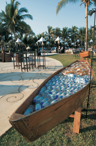 bottled-water-and-beer-in-wood-boat-at-wedding-reception