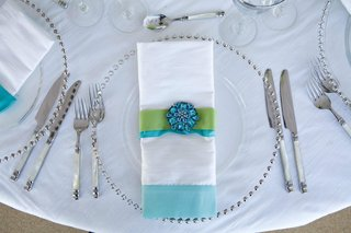 silver-beaded-charger-plates-and-blue-linens