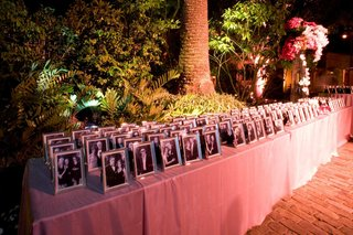 table-with-photos-of-guests-in-silver-frames