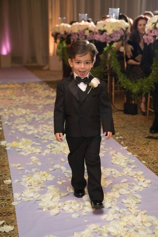 little-boy-in-tux-sticking-tongue-out