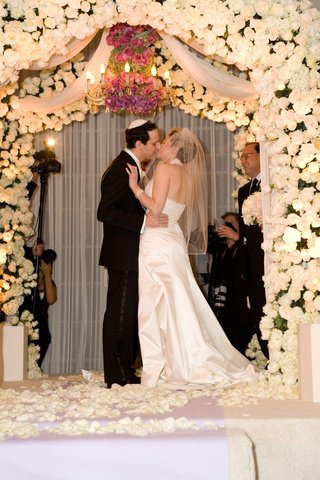 bride-and-groom-kissing-under-chuppah
