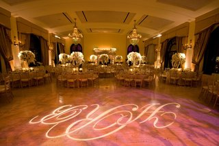 monogram-dance-floor-and-chandliers