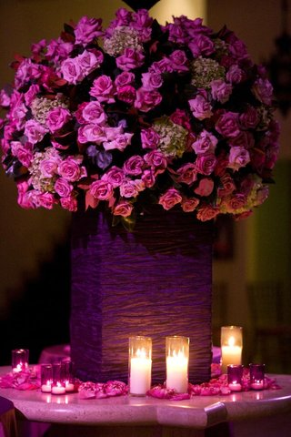 fuchsia-flowers-surrounded-by-petals-and-candles