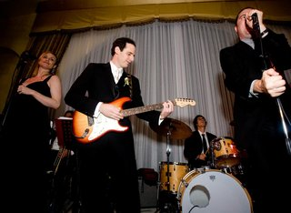 wedding-band-performing-on-stage-with-groom