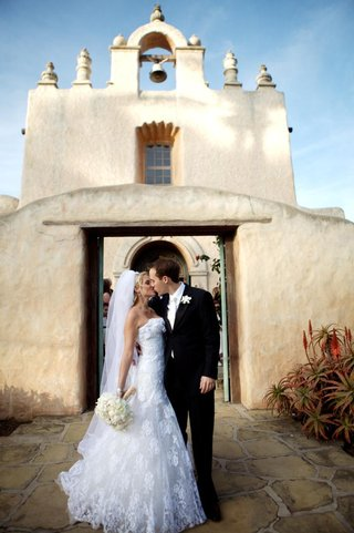 bride-and-groom-in-front-of-adobe-style-church