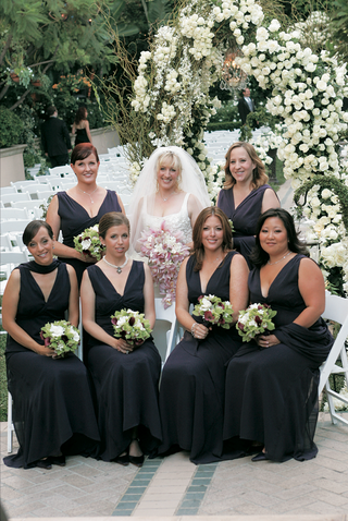 long-purple-bridesmaids-dresses-with-matching-wraps-and-green-white-and-purple-bouquets