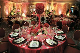 reception-table-with-red-tablecloth-and-red-rose-flower-arrangements