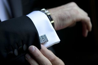 silver-cufflinks-with-circles-and-braid-details