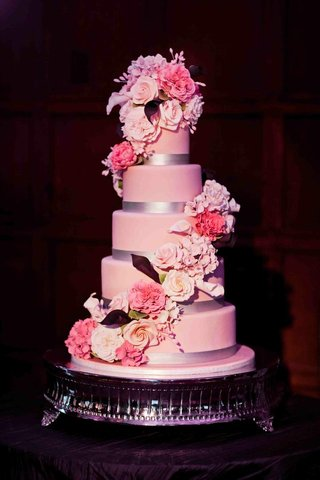 pink-cake-with-silver-ribbon-and-sugar-flowers