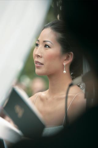 bride-wearing-diamond-and-pearl-drop-earrings