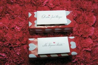 escort-cards-attached-to-boxes-with-heart-wrapping-paper