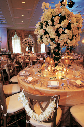 gold-tablecloths-and-tree-centerpieces-at-the-townsend