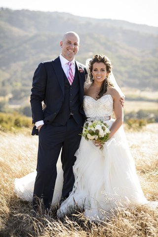 man-wearing-three-piece-suit-and-woman-in-wedding-dress