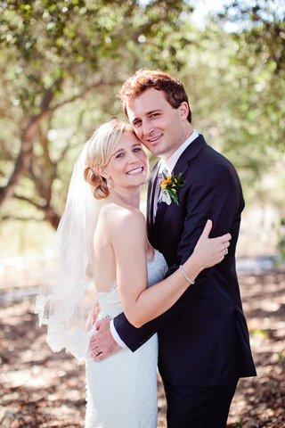 blonde-woman-in-wedding-dress-and-man-in-tuxedo