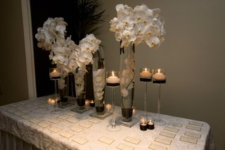 submerged-orchids-and-floating-candles-on-table