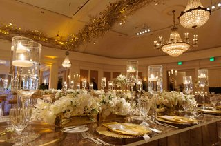 ballroom-wedding-with-chandeliers-and-gold-branches