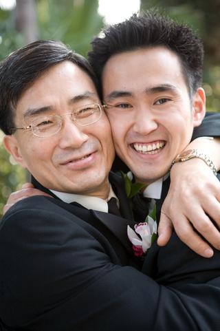 father-and-son-hug-on-wedding-day