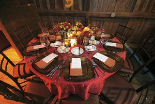 red-table-at-barn-wedding-with-fall-wedding-flowers