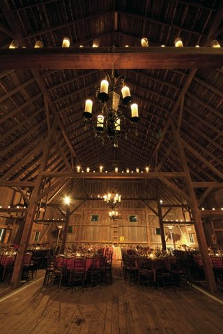 barn-wedding-chandelier-and-candles-on-rafters