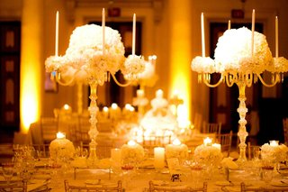 table-decor-with-crystal-pedestals-and-tall-candles-and-white-flowers