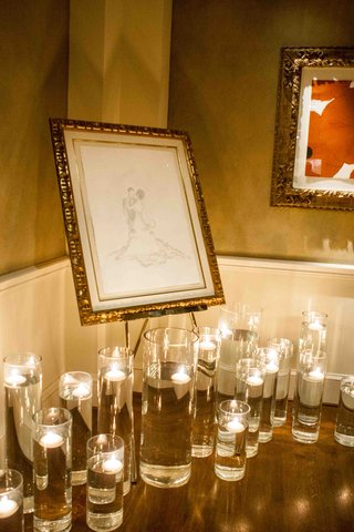 hurricane-vases-with-floating-candles-under-custom-drawing